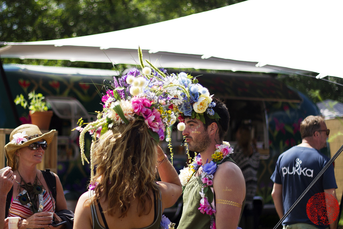 festival-goers wearing flower garlands at somersault festival 2015