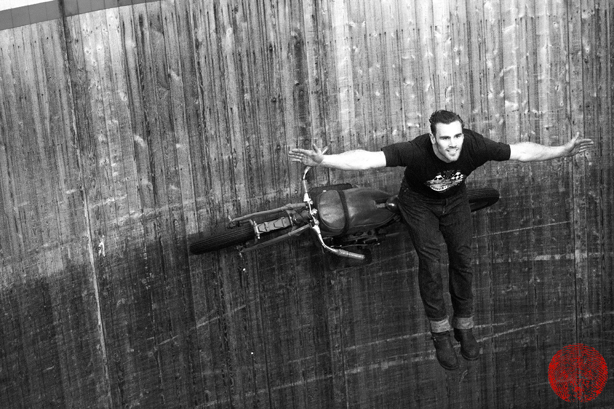 the duke performing the iron cross on a vintage indian motorcycle on the demon drome wall of death