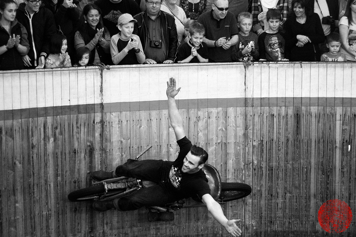 the duke riding a vintage indian motorcycle at audience level on the demon drome wall of death