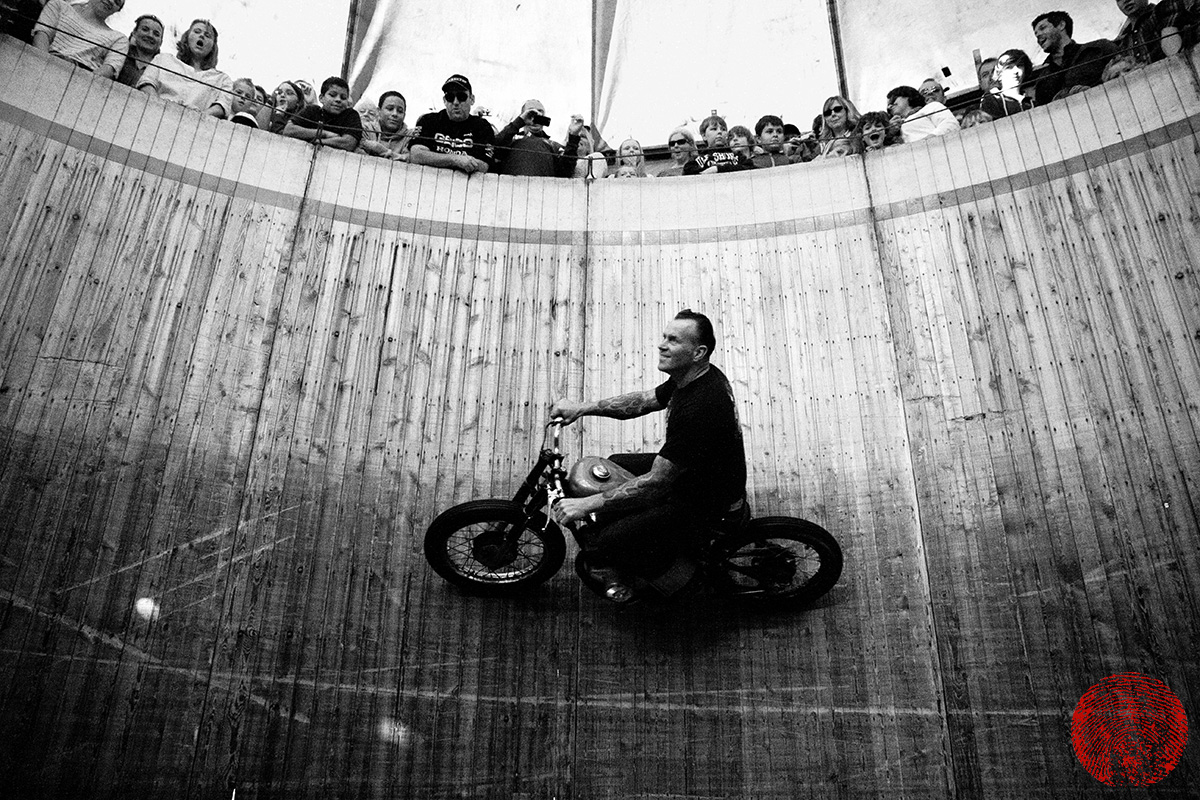 dynomyte dave seymour riding a honda hardtail around the demon drome wall of death