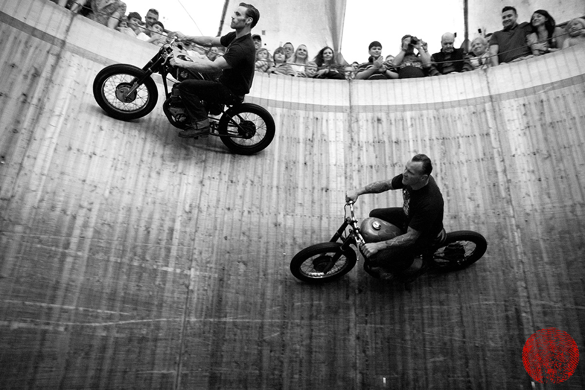 dynomyte dave seymour and the duke racing each other around the demon drome wall of death