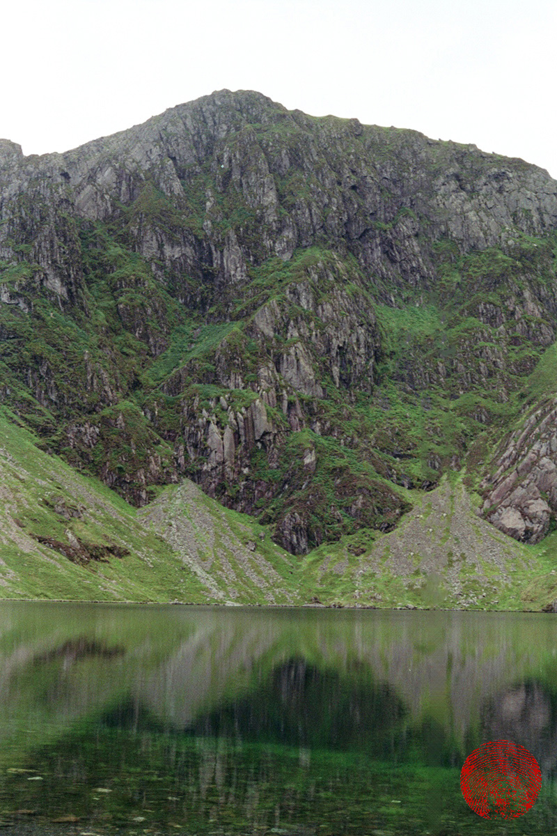 looking up to the peak of cadair idris from llyn cau, the lake beneath it